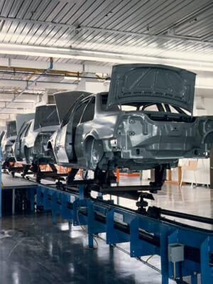 Inverted paint conveyor for automotive application