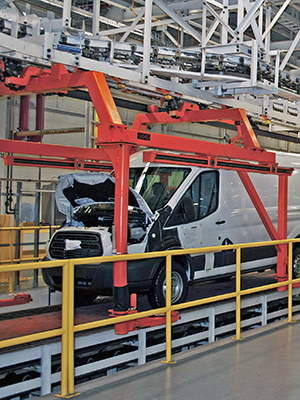 overhead conveyor to deck on flattop for automotive application